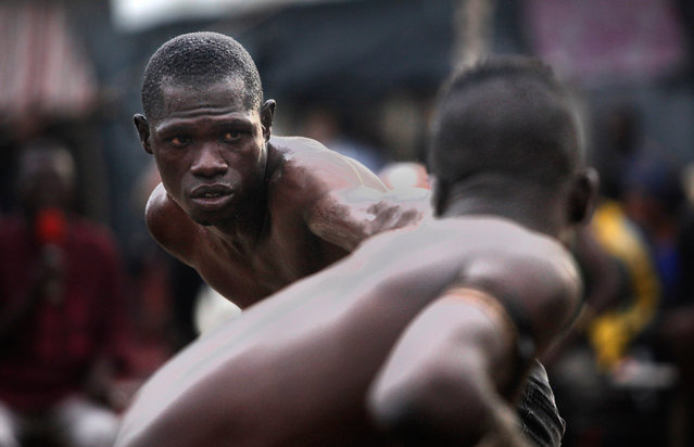 Boxers compete in a traditional combat sport known as 'Danbe' at a gym in Lagos, Nigeria, 28 June 2020. Danbe is a popular discipline among the Hausa-Fulani people from the northern part of Nigeria. The fights feature live commentary in the Hausa language as well as traditional musical entertainment. (Photo by Akintunde Akinleye/EPA/EFE)
