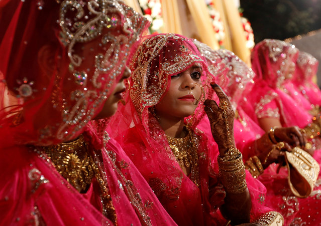 Muslim brides wait for the start of a mass marriage ceremony in Mumbai, India, November 20, 2017. (Photo by Danish Siddiqui/Reuters)