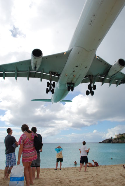 Spent the majority of the day at Maho Beach, right at the end of the runway for the Princess Juliana International Airport on the Sint Maarten side. Because the public beach and road are at the very end of the runway, you can experience the large (and small) airplanes landing and taking off. (Photo by Curtis & Renee)