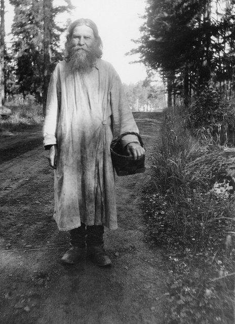 Russian Orthodox monk with a birchbark basket, Valamo Monastery, Karelia, Russia (then Finland), 1930s. (Photo by Einar Erici)