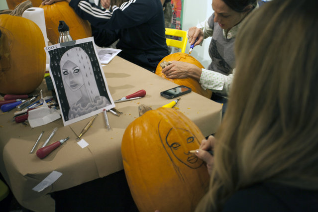 Artist Tara McPherson works on drawing on a stencil on a pumpkin at Cotton Candy Machine in Brooklyn, N.Y. on October 18, 2014. (Photo by Siemond Chan/Yahoo Finance)