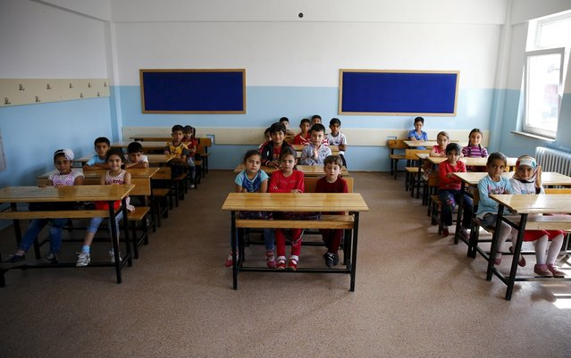 Syrian refugee students in second grade wait for the start of their first lesson of the year at Fatih Sultan Mehmet Primary School in Ankara, Turkey, September 28, 2015. (Photo by Umit Bektas/Reuters)