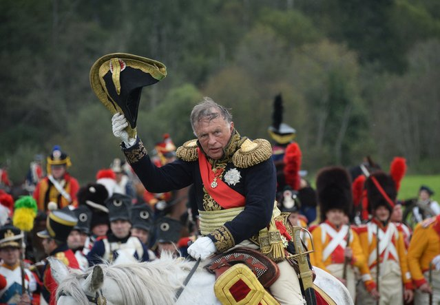 A participant in the military historical reconstruction of the Battle of Borodino during presentation in Borodino Field, Moscow Region on September 4, 2016. (Photo by Kirill Kallinikov/Sputnik)
