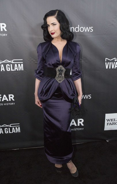 Burlesque dancer Dita Von Teese poses at amfAR's Fifth Annual Inspiration Gala in Los Angeles, California October 29, 2014. (Photo by Mario Anzuoni/Reuters)