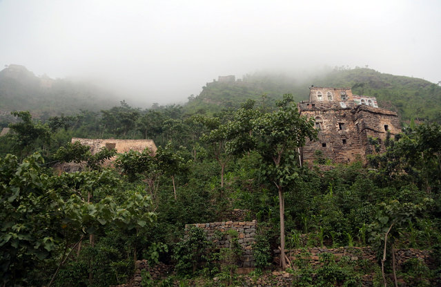 Houses are seen in the mountains, in the Jafariya district of the western province of Raymah, Yemen May 20, 2016. In villages perched high on a mountain in Western Yemen, residents are a safe distance from a conflict raging throughout most of the country but have had to turn the clock back on their lifestyles by centuries. Eighteen months of civil war and shortages have deprived Yemen's 28 million people of electricity and fuel – dinner is cooked on an open fire and dawn light heralds a the start of work in the fields. But far from a country idyll, starvation and a lack of vital medicine have turned sunny days in the crisp green hills into a medieval struggle for survival. People in the Jafariya district of the western Raymah province must now haul basic goods uphill by foot, donkey and even a pulley-powered cable car soaring between peaks. (Photo by Abduljabbar Zeyad/Reuters)