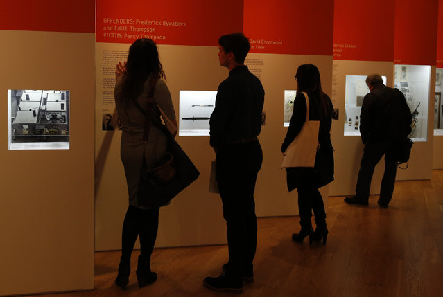 Members of the media look at exhibits on display during a press preview for the Crime Museum Uncovered exhibition at the Museum of London in the City of London, Wednesday, October 7, 2015. (Photo by Alastair Grant/AP Photo)