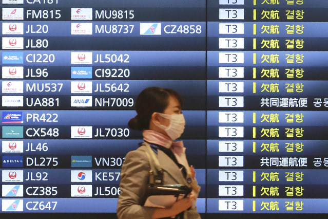A woman wearing a face mask to protect against the spread of the coronavirus walks in the Haneda International Airport in Tokyo, Tuesday, September 1, 2020. Major Asian share indexes edged lower Tuesday in mostly muted trading after a retreat overnight on Wall Street. (Photo by Koji Sasahara/AP Photo)