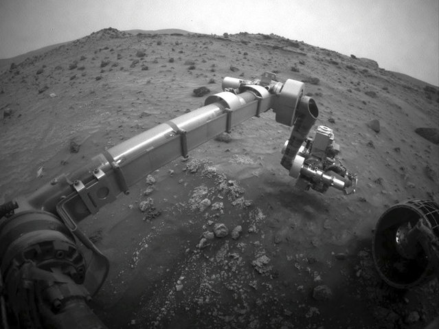 Opportunity's twin rover, Spirit, on its 1,277th sol. Spirit became stuck in soft soil in late 2009, and its last communication with Earth was sent on March 22, 2010. (Photo by AP Photo/NASA/The Atlantic)