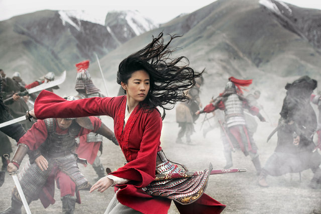 """This image released by Disney shows Chinese-born American actress Yifei Liu in the title role of the Walt Disney Company's 2020 live-action film """"Mulan"""". (Photo by Jasin Boland/Disney via AP Photo)"""