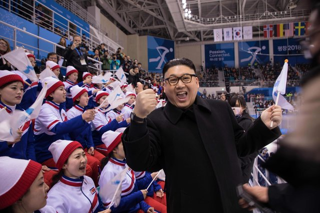 A man impersonating North Korean leader Kim Jong Un gestures as he stands before North Korean cheerleaders attending the Unified Korean ice hockey game against Japan during the Pyeongchang 2018 Winter Olympic Games at the Kwandong Hockey Centre in Gangneung on February 14, 2018. (Photo by Yelim Lee/AFP Photo)
