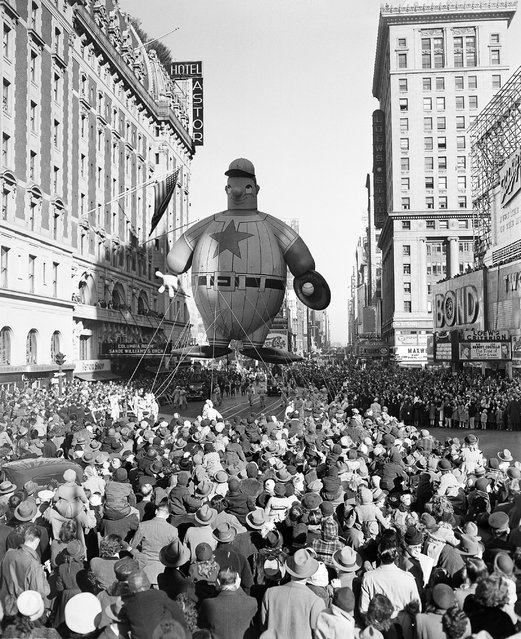 A giant baseball player float moves down 7th Avenue during the Macy' Thanksgiving Day Parade on November 28, 1946. (Photo by John Rooney/AP Photo)