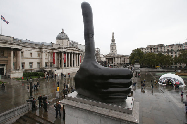 "The new Fourth Plinth sculpture, ""Really Good"" by British artist David Shrigley is pictured in Trafalgar Square in central London on September 29, 2016. Artist David Shrigley is best known for his distinctive drawing style and works that make satirical comments on everyday situations and human interactions. Shrigley's sculpture for the Fourth Plinth, ""Really Good"", is a seven-metre high hand with a disproportionately long thumb giving a thumbs up. (Photo by Daniel Leal-Olivas/AFP Photo)"