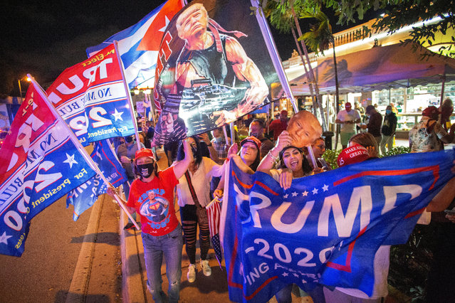 US President Donald Trump's supporters celebrate in front of the Versailles restaurant in Miami, Florida, USA, 03 November 2020. Americans vote on Election Day to choose between re-electing Donald J. Trump or electing Joe Biden as the 46th President of the United States to serve from 2021 through 2024. (Photo by Cristobal Herrera-Ulashkevich/EPA/EFE)
