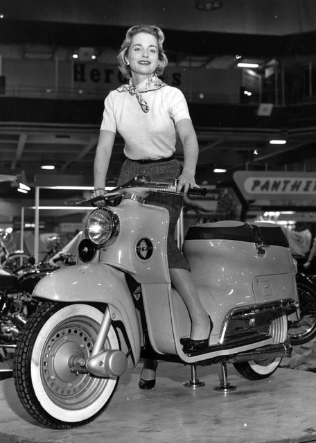 Film star Josephine Griffin posing on the new B.S.A Beeze Scooter at the Cycle and Motorcycle Show at Earls Court in London, 11th November 1955. (Photo by L. Blandford/Topical Press Agency/Getty Images)