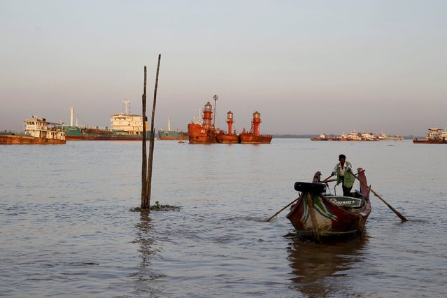 A man rows his boat in Yangon river October 23, 2015. (Photo by Soe Zeya Tun/Reuters)