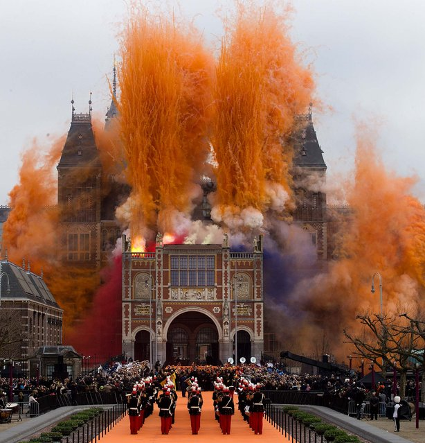 """Fireworks explode during the official opening of the renovated Rijksmuseum in Amsterdam, Netherlands, on April 13, 2013. The Rijksmuseum, home of Rembrandt's """"The Night Watch"""" and other national treasures, reopensed its doors to the public after a decade-long renovation. (Photo by Peter Dejong/Associated Press)"""