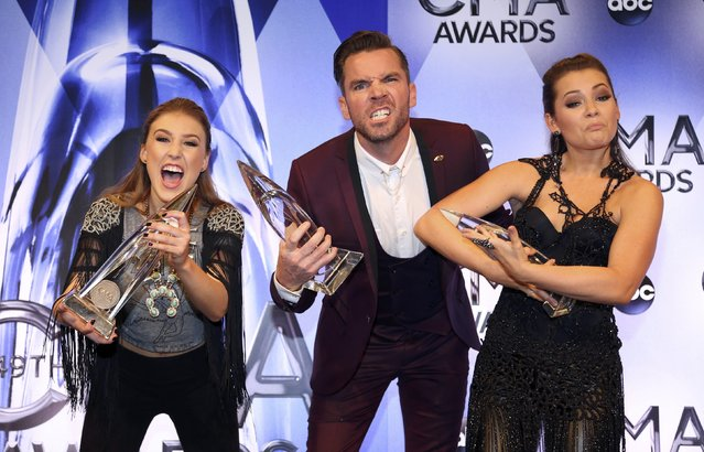 "Maddie Marlow (L), director TK McKamy and Tae Dye pose backstage with their award for Music Video of the Year for the Maddie & Tae song ""Girl In A Country Song"" during the 49th Annual Country Music Association Awards in Nashville, Tennessee November 4, 2015. (Photo by Jamie Gilliam/Reuters)"