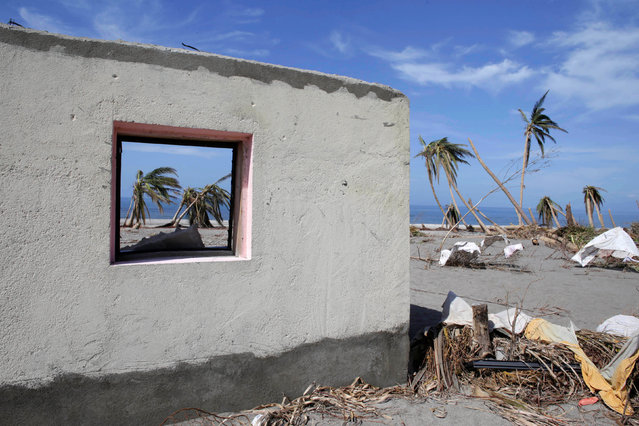 Palms are seen through the window of a house destroyed by Hurricane Matthew in Coteaux, Haiti, October 9, 2016. (Photo by Andres Martinez Casares/Reuters)