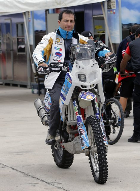 Argentina's Santiago Ontiveros riding his Beta motorcycle arrives for technical verification ahead of the Dakar Rally 2015 in Buenos Aires January 1, 2015. (Photo by Enrique Marcarian/Reuters)