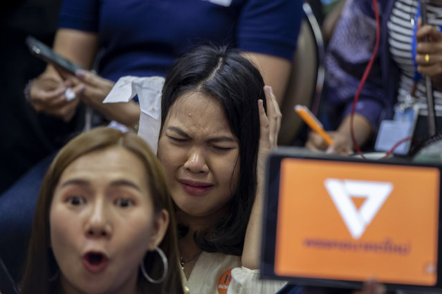 Supporters of Thailand's Future Forward Party react as they watch a live television broadcast of a court verdict at their party's headquarters in Bangkok, Thailand, Friday, February 21, 2020. Thailand's Constitutional Court on Friday ordered the popular opposition Future Forward Party dissolved, declaring that it violated election law by accepting a loan from its leader. The court also imposed a 10-year ban on the party's executive members holding political office. (Photo by Gemunu Amarasinghe/AP Photo)