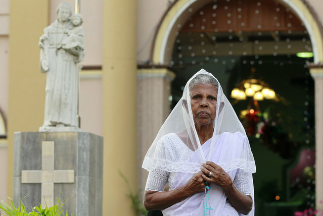 In this Tuesday, January 6, 2015 photo, Sri Lankan Catholic devotee Philimina Wickremasinghe, 73, poses for a photograph outside a church in Colombo, Sri Lanka. Wickremasinghe said that she was happy to be a Catholic and that the approval of canonization of Joseph Vas was a blessing. (Photo by Eranga Jayawardena/AP Photo)