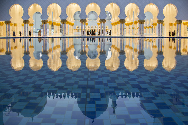 """Sheikh Zayed Mosque"". A reflection of the Sheikh Zayed Grand Mosque in the basin of the fountain opposite the mosque where the main dome of the mosque appears. Location: Abu Dhabi, United Arab Emirates. (Photo and caption by Dhafer Al Shehri/National Geographic Traveler Photo Contest)"