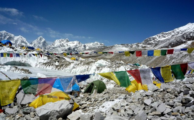 This photograph taken on May 17, 2009, shows a general view of Everest Base Camp in Nepal. Scores of Nepalese guides and foreign climbers on Mount Everest packed up April 24, 2014, loading supplies onto yaks and booking helicopters, with the climbing season increasingly in doubt after an avalanche killed 16 people last week. Expeditions prepared to leave shortly after crisis talks ended with the Nepal government at Everest base camp in the wake of the worst ever accident on April 18, on the world's highest peak. (Photo by Pemba Dorje Sherpa/AFP Photo)