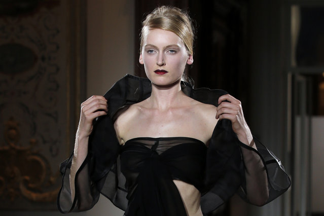 A model wears a creation by designer Gustavo Lins for fashion house Atelier Gustavolins during their Spring-Summer 2015 Haute Couture fashion collection, presented in Paris, France, Tuesday, January 27, 2015. (Photo by Francois Mori/AP Photo)