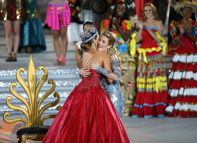 Miss Spain, Mireia Lalaguna Royo (R) hugs former Miss World Jolene Strauss from South Africa after winning the Miss World title during the grand final of the 65th Miss World pageant at the Beauty Crown Hotel Complex in Sanya, Hainan province, China, 19 December 2015. (Photo by How Hwee Young/EPA)