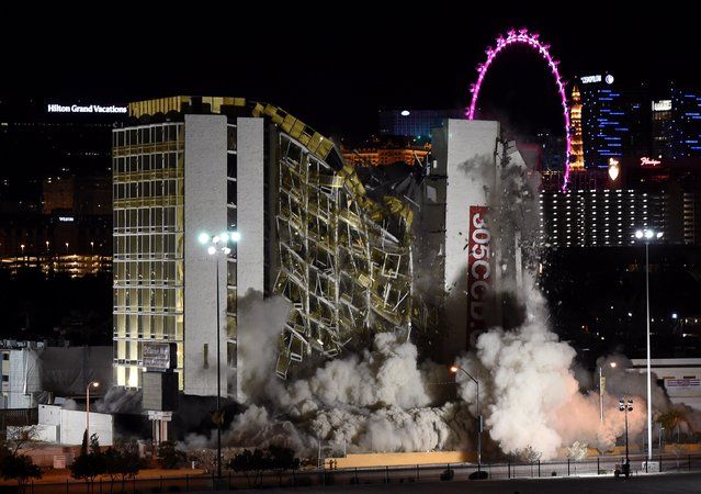 The Clarion Hotel and Casino is imploded on February 10, 2015 in Las Vegas, Nevada. It is the first casino implosion in Las Vegas since the New Frontier Hotel & Casino was brought down in 2007. The 12-story Clarion, located just off the Las Vegas Strip, opened in 1970 as the Royal Inn and changed ownership over the years becoming known by several names including the Royal Americana Hotel, The Paddlewheel Hotel Casino, the Debbie Reynolds Hollywood Hotel and the Greek Isles Hotel & Casino. (Photo by Ethan Miller/Getty Images)