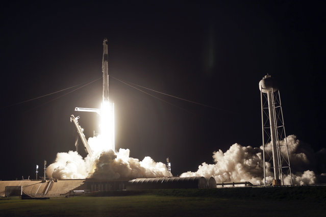 A SpaceX Falcon 9 rocket with the Crew Dragon space capsule lifts off from pad 39A at the Kennedy Space Center in Cape Canaveral, Fla., Friday, April 23, 2021. (Photo by John Raoux/AP Photo)