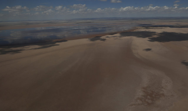 In this January 16, 2016 aerial photo, shows a view of Lake Poopo, Bolivia. High on Bolivia's semi-arid Andean plains at 3,700 meters (2.3 miles) and long subject to climatic whims, the shallow saline lake has dried up before, most recently in the 1940s, only to rebound to an area twice the size of Los Angeles. (Photo by Juan Karita/AP Photo)