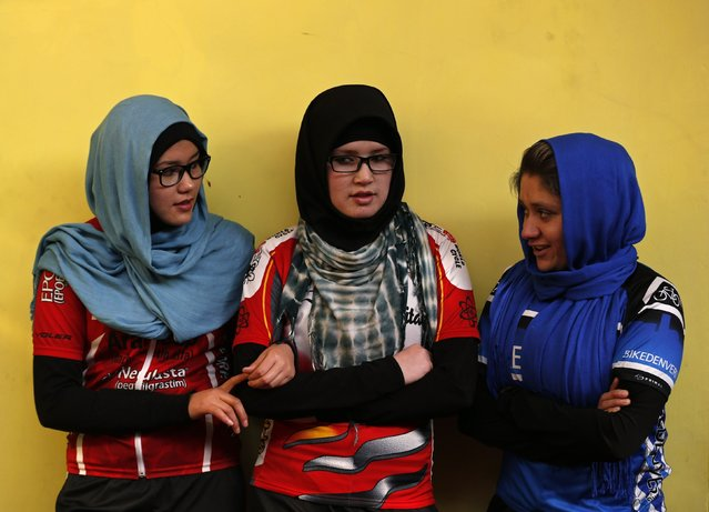 Masooma Alizada (L), Zahra Alizada (C), and Frozan Rasooli (R), members of Afghanistan's Women's National Cycling Team talk with each other before training in Kabul February 20, 2015. (Photo by Mohammad Ismail/Reuters)