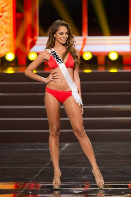 This photo provided by the Miss Universe Organization shows Hinarani de Longeaux, Miss France 2013, competes in the swimsuit competition during the Preliminary Competition at Crocus City Hall, Moscow, on November 5, 2013. (Photo by Darren Decker/AFP Photo)