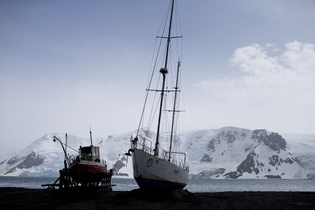 In this January 27, 2015 photo, boats sit on the beach at Bahia Almirantazgo, Antarctica. Most visitors arrive on the Antarctic Peninsula, accessible from southern Argentina and Chile by plane or ship. The next most popular destination is the Ross Sea on the opposite side of the continent, which visitors reach after sailing 10 days from New Zealand or Australia. (Photo by Natacha Pisarenko/AP Photo)
