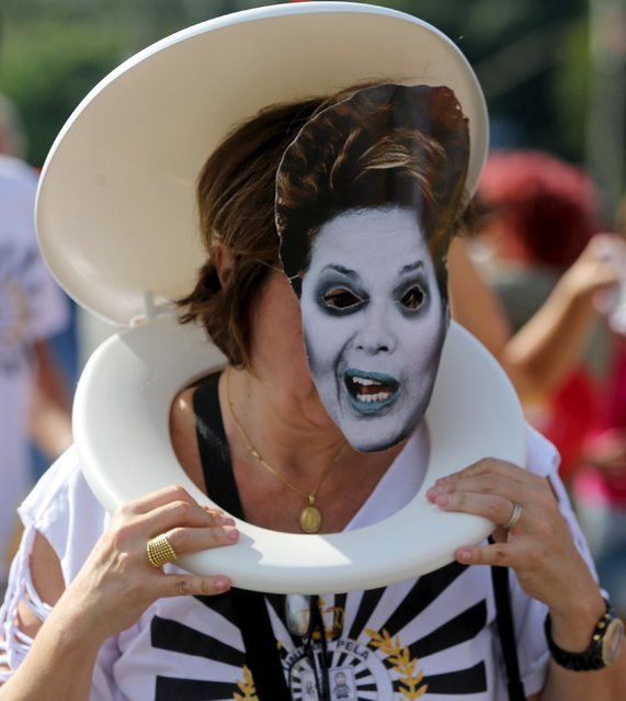 """A reveller, wearing a mask depicting Brazilian President Dilma Rousseff, takes part in a block street party known as """"Lava Jato"""" (Car Wash) during carnival celebrations in Sao Paulo, Brazil, January 30, 2016. """"Lava-Jato"""", or """"Operation Car Wash"""", is the name of a federal police operation investigating suspected corruption at state oil company Petrobras. (Photo by Paulo Whitaker/Reuters)"""