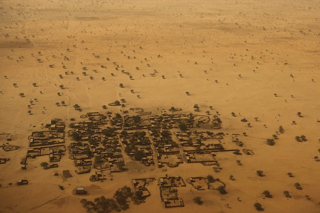 An aerial view shows houses outside the town of Diffa, March 21, 2015. (Photo by Joe Penney/Reuters)