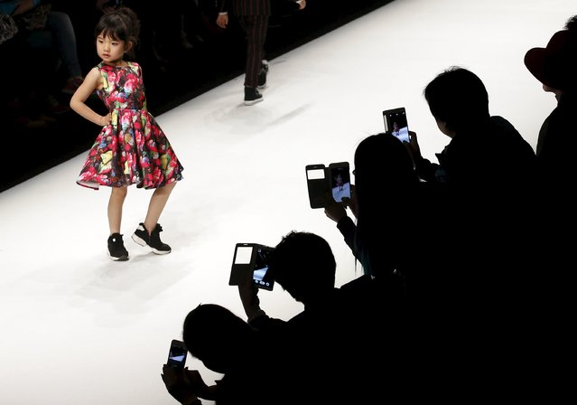 A child model presents a creation from the SUN TOMORROW Children's Collection during China Fashion Week in Beijing March 31, 2015. (Photo by Kim Kyung-Hoon/Reuters)