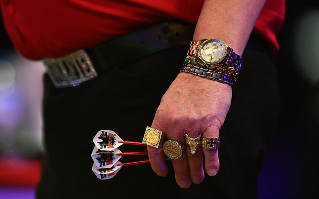A detailed view of the jewellery of Martin Adams of England during his Mens Quarter Final match against Jamie Hughes of England on day seven of the BDO Lakeside World Professional Darts Championships at the Lakeside Country Club on January 13, 2017 in Frimley, England. (Photo by Dan Mullan/Getty Images)