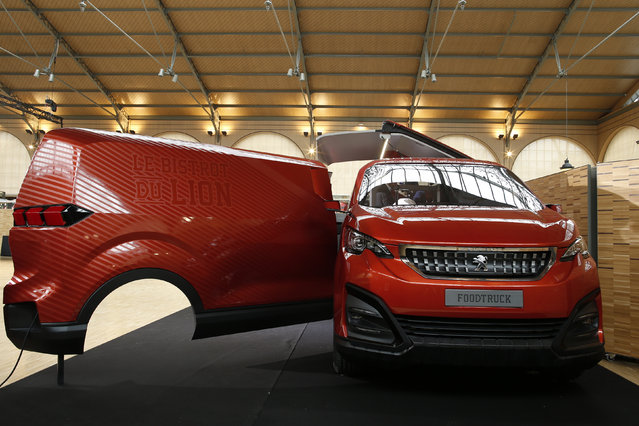 The Peugeot food truck, named Le Bistrot du Lion, is seen during a press presentation in Paris April 2, 2015. The Peugeot Food truck, designed by Peugeot Design Lab, will be shown at the Milan Design Week 2015 on April 14 before joining the French Pavilion at the 2015 Universal Exhibition in Milan. (Photo by Benoit Tessier/Reuters)