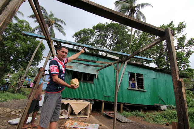 A roadside coconut vender shows the damage to his house from Cyclone Winston in Raiwaqa as a cleanup continues in the aftermath of the storm in Fiji's capital Suva, February 22, 2016. (Photo by Steven Saphore/Reuters)
