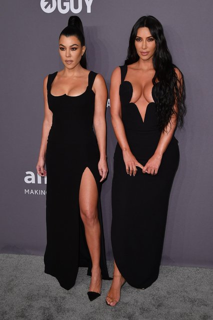 US media personalities Kourtney Kardashian (L) and sister Kim Kardashian West arrive to attend the amfAR Gala New York at Cipriani Wall Street in New York City on February 6, 2019. (Photo by Angela Weiss/AFP Photo)