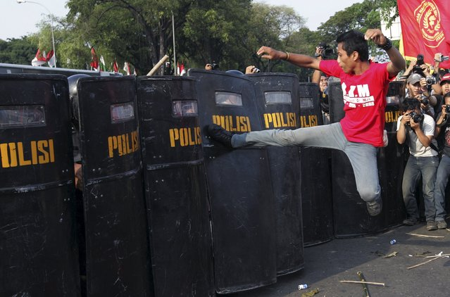 A student protester clashes with the police during a rally against the government's plans to increase fuel prices, in front of the presidential palace in Jakarta, in this May 21, 2008 file photo. (Photo by Dadang Tri/Reuters)
