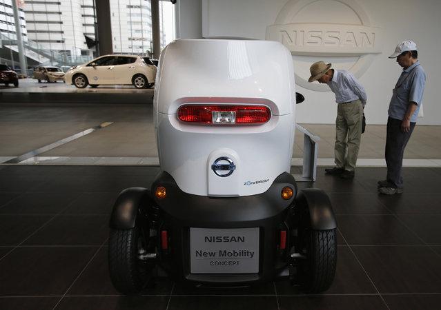Visitors look at Nissan Motor Co's New Mobility concept car at the company's showroom in Yokohama, south of Tokyo, May 10, 2013. (Photo by Toru Hanai/Reuters)