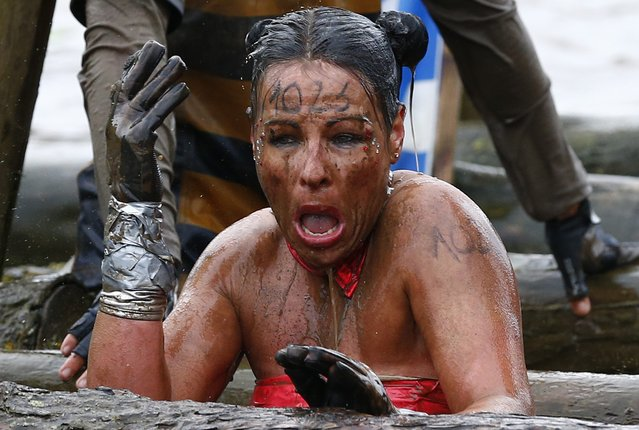 A competitor reacts as she emerges from the water during the Tough Guy event in Perton, central England, January 26, 2014. (Photo by Darren Staples/Reuters)