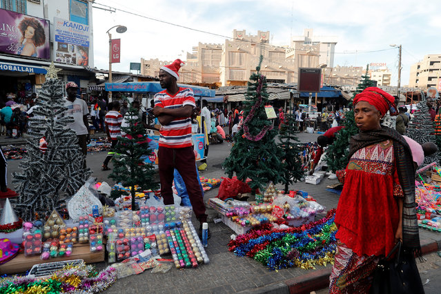 Omar Diop, 34, a street vendor sells Christmas decorations on a street in Dakar, Senegal on December 18, 2018. Picture taken December 18, 2018. (Photo by Zohra Bensemra/Reuters)