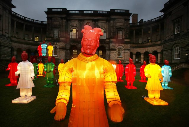 Larger than life lanterns inspired by  the Terracotta Warriors, created by artist Xia Nan for the Beijing Olympics are lit up at Edinburgh university for the first time in Scotland. (Photo by David Cheskin/PA Wire)