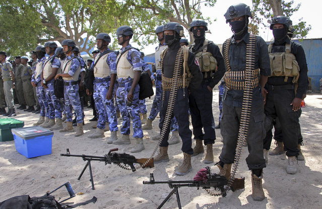 Somali soldiers prepare to secure the capital on the eve of presidential elections, at a police academy in Mogadishu, Somalia Tuesday, February 7, 2017. Graft – vote-buying, fraud, intimidation – is the top concern in a nation that Transparency International now rates as the most corrupt in the world and Mogadishu is in lockdown because of the threat of violence by homegrown Islamic extremist group al-Shabab. (Photo by Farah Abdi Warsameh/AP Photo)