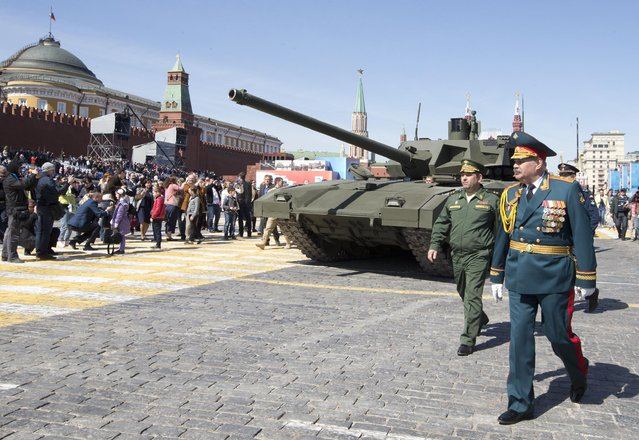 A crew member of new Russian T-14 Armata drives his tank away from Red Square during a preparation for general rehearsal for the Victory Day military parade which will take place at Moscow's Red Square on May 9 to celebrate 70 years after the victory in WWII, in Moscow, Russia, Thursday, May 7, 2015. (Photo by Alexander Zemlianichenko/AP Photo)