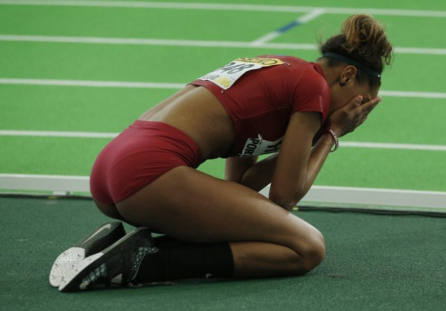 Yulimar Rojas of Venezuela reacts after winning the gold medal in the women's triple jump during the IAAF World Indoor Athletics Championships in Portland, Oregon March 19, 2016. (Photo by Mike Blake/Reuters)